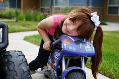 Ella on wheels (Clever Poet) Tags: ponytail smile adorable ride atv family rider motorcycle mini young cute ella ellaonwheels