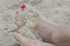Feet in the Sand (brucetopher) Tags: pretty feet toe toes foot barefoot barefeet sandy painted pink fuchsia skin beach sand woman toenail toenails pedicure summer vacation holiday beauty beautiful stunning ankle ankles