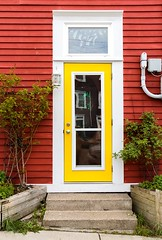 Come In (Karen_Chappell) Tags: door red yellow white green entryway entry house home downtown city urban jellybeanrow rowhouse stjohns newfoundland nfld atlanticcanada avalonpeninsula canada eastcoast architecture window colourful colours colour color wood wooden paint painted steps