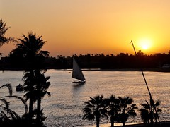 Magical Places and Things -Egypt- The Nile (3) (The Spirit of the World ( On and Off)) Tags: felucca sails sailboat nile thenile mast sun sunset reflections evening luxor egypt middleeast africa calm peaceful river timeless silhouettes