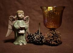 Still Life with Angel (N.the.Kudzu) Tags: tabletop stilllife angel pine cone goblet dead flower canon70d manualfocus primelens lensbabyburnside35