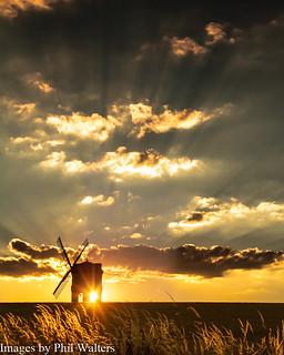 Sunset through a windmill