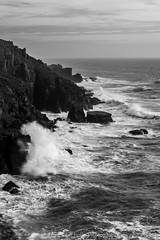 The Clash (James Etchells) Tags: cornwall kernow lizard peninsula point national trust coast coastal rock rocks rocky coastline sea ocean water waves black white monochrome portrait landscape landscapes seascape seascapes south west england britain uk nikon photography sky wave