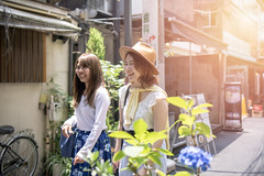 Young female friends walking on narrow street in summer (Apricot Cafe) Tags: img96536 asia asianandindianethnicities hydrangea japan japaneseethnicity shibuyaward tokyojapan capitalcities carefree casualclothing colorimage day enjoyment friendship happiness harajukudistrict leisureactivity lifestyles longhair nature outdoors people photography realpeople smiling straghthair strawhat street summer sunlight sustainablelifestyle talking threequarterlength togetherness toothysmile twopeople walking weekendactivities women youngadult shibuyaku tōkyōto jp