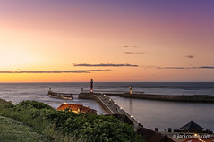 Whitby pier at sunset. (jack cousin) Tags: northsea uk whitby yorkshire bush coast grass harbor harbour holiday light lighthouse lights lit nature night outdoor pier popular port resort roof sea seascape seashore shore shrub sunset tourism touristattraction town travel vacation water nikond610 on1photos