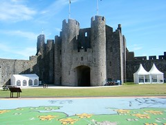 Pembroke Castle, Wales (rossendale2016) Tags: preserved history safe grass lawns stone tall high wooden soldiers icon iconic library slots arrow walkway walking value good clean neat photogenic picturesque excellent renovated army fortified walls ramparts wales south castle pembroke