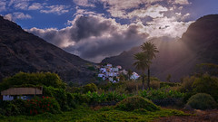La Calera (Jörg Bergmann (off)) Tags: 20mmf17 finca islascanarias lacalera lagomera lamérica panasonic20mmf17 teguerguenche vallegranrey amanecer backlight blossoms canarias canaryislands clouds contraluz españa gf7 gomera greenery hiking landscape light lumix lumix20mm m43 mft micro43 microfourthirds mountains palmtrees panasonic plátanos sky spain sun sunbeams sunrays sunrise travel vacation valley village paraisodelmar sunlight summer 2018 cabin