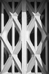 Bars (Djaron van Beek) Tags: abstract geometry geometric pattern thickbars bw blackandwhite texture architectural window architectwillemanthoniefroger buildingfrom1867 amsterdam detailofabuilding minimal minimalism monochrome symmetry diamonds lamp lines crossinglines heavymetal steel ironworks barred joints bwartaward djaron djaronvanbeek