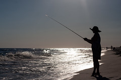 Fishing (Jeremy Caney) Tags: beach coast dress dusk fishing florida gulfofmexico hat katie katiesfamily ocean saltwater silhouette sundress sunhat sunset trips vacation water waves woman