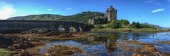 Eilean Donan Castle (EricMakPhotography) Tags: scotland castle bridge sea river green panorama tourism water historic