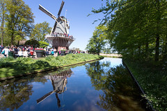 Reflections of a mill in Keukenhof  _3367 (hkoons) Tags: northsea westerneurope atlantic city europe european holland keukenhof netherlands springtime tree windmills arbor beautiful beauty bloom blooms blossom branch branches bud buds canals canopy coast coastal color dykes energy flora flower flowers garden green growth landscape leaf leaves limb limbs mill mills ocean outdoors pretty roots sea soil spring stem sun sunshine tidal trees trunk tulips waterways wind windmill