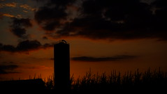 Nebraska Grain Bin (Tim @ Photovisions) Tags: nebraska corn bin silo sun sunset sunrise dawn dusk sky storage grain clouds