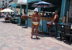 Yellow Mellow (Andy Zito) Tags: mellow yellow lady with white bikini rear view hollywood beach bar cafe couple looking south florida