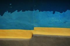 Innate Minimalism. (Gattam Pattam) Tags: wall minimalism colours sun light house abstract pattern architecture rural india chhattisgarh street lines yellow blue brown texture