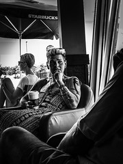 Fierce. Windsor, ON. (Paul Thibodeau) Tags: photooftheday windsor iphone8plus iphoneography streetphotography blackandwhite monochrome facesincoffeeshops starbucks woman tattoos strong