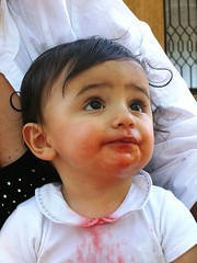 Lollo piccino (giòvanna) Tags: lorenzo bambini anguria rosso bianco macchie sguardo cibo
