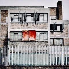 IMG_8154 (Kathi Huidobro) Tags: urbandecay officeblock offices secure facade gentrification architecture concrete building urbanscene urban london texture rust windows brickedup derelict abandoned