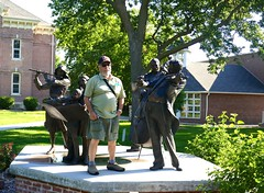 "Ali with ""Joy of Music,"" 5-piece bronze sculpture by George Lundeen, Hastings College (ali eminov) Tags: hastings nebraska colleges hastingscollege sculptors sculptures joyofmusic people ali georgelundeen"