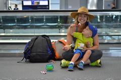 Sharing (radargeek) Tags: den denver airport travel colorado travelers traveler baby kid kids children mother son sharing hat