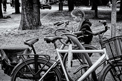 The Message (Alfred Grupstra) Tags: bicycle blackandwhite people outdoors women lifestyles females cycling oneperson youngadult urbanscene adult street citylife cycle casualclothing sitting day beauty