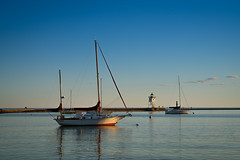 Grand Marais, Minnesota 20180705-DSC07970 (Rocks and Waters) Tags: sonyalpha 1807xxnorthshore blue grandmarais greatlakes lakesuperior zeiss a7r2 boats goldenhour harbor lighthouse loxia loxia2485 sailboats sony sunset water
