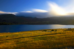Low Clouds Crossing over the Hills and Lake (milton sun) Tags: lowclouds lowfog sanmateo california crystalspringsreservoir longexposure bayarea landscape outdoor clouds sky water rock mountain rollinghills cliff nature lake grass fence