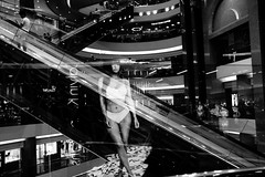 The ghost of commercialism (Scofield Chan) Tags: street streetsnap snapshot streetphoto documentary monochrome bw blackandwhite asia advertisement city urban shadow contrast shopping hongkong fujifilm fujinon x100f 35mm xf23mmf2