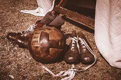 Footie (aquanout) Tags: football boots grass socks monochrome sepia stilllife