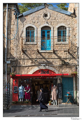 Woman in Black (Raul Kraier) Tags: jerusalem woman black religion creed street building stones diversity balcony windows table chair