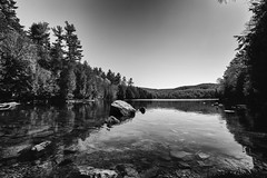Meech Lake (SNAPShots by Patrick J. Whitfield) Tags: landscape water shores beach wet reflections nature outside skies blackwhite bw noiretblanc noire monochrome lines patterns texture detail dof rocks light
