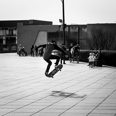 SK8 (Go-tea 郭天) Tags: dalian liaoning xinghai square sk8 skate board skateboard skateboarder ride riding rider jump trick audience young man boy sport candid sun sunny shadow movement train training canon eos 100d 50mm prime street urban city outside outdoor people bw bnw black white blackwhite blackandwhite monochrome naturallight natural light asia asian china chinese