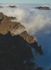 Mountains above the clouds (lingtotheyang) Tags: clouds mountain mountains mountaintop nature canon sky island landscape mountainside rock
