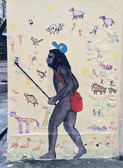 Neanderthal Selfie (cowyeow) Tags: hongkong china chinese asia asian sign city street funnychina funny funnyhongkong kowloon mongkok art streetart design caveman neanderthal painting folkart primitive mural selfie