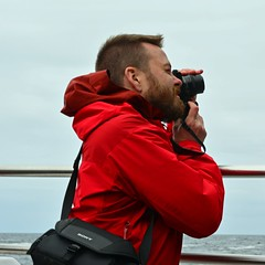 A photographer (mikael_on_flickr) Tags: photographer fotografo fotograf belo handsome beard barba red rosso rouge rød rot man uomo mann ragazzo atsea føroyar færøerne faroeislands isolefaroe