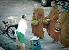Morning offering (stormymayen) Tags: monks prayer woman boy offering spiritual buddhism