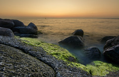 Sunset Sailing (ubinas) Tags: sailing sunset sea wideangle rocks seaweed