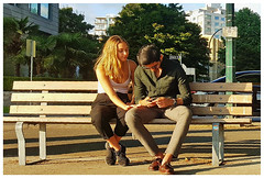 Supportive Texting (HereInVancouver) Tags: youngcouple lifeonaparkbench candidvancouvers west endtextingphoneemotional supportmobile phone photosamsung galaxy s6 summertime sunshine outdoors urban city vancouver bc canada
