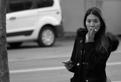 6-19 Candids 41 (TheseusPhoto) Tags: blancoynegro blackandwhite monochrome monotone noir people streetphotography street candid sanfrancisco marketstreet city citylife woman girl cigarette smoking face streetportrait