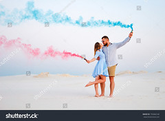 young couple kissing and holding colored smoke in hands, romantic couple with blue color and red color smoke bomb on beach (ig_royal6969) Tags: and beach barkhans love happiness kiss man woman boyfriend girl girlfriend boy red blue smoke rest bomb hugs romantic story couple family care fire paint hands color desert ocean sea cheerful fun summer people nature happy sky outdoors friendship sunset party two person spring holding vacation together relationship travel lifestyle honeymoon sale shutterstock