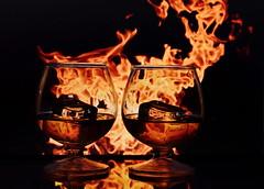 Twin Fireball - Cinnamon Whiskey (Caroline.32) Tags: flickrfriday twins fireball cinnamonwhiskey fire whiskey reflection icecube two nikond3200 50mm18 niftyfifty