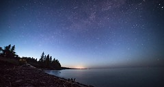 Timelapse of the Milky Way on Lake Superior - Duluth, MN (Gian Lorenzo) Tags: astronomy background beautiful clouds color contemporary dark establishingshot evening hyperlapse isolated isolation lake lakesuperior landscape light lowangle milkyway moon nature night nopeople seamlesslooping silhouette sky space star stars starsmoving summer sun timelapse timelapsepassing tree universe water wideanglelens wild wilderness