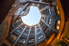 gaudi's moon 高迪之月 (nzfisher) Tags: gaudi moon architecture building pedrera round shape lines circular barcelona spain travel holiday window 24mm canon orange patio