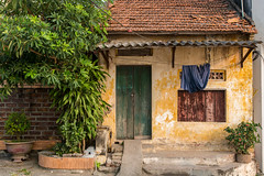 Humble Abode in Bat Trang, Vietnam (Jill Clardy) Tags: asia battrang hanoi vietnam village ceramic manufacturing pottery workshop 201410144b4a7817 home shack peeling paint rustic explore explored