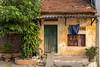 Humble Abode in Bat Trang, Vietnam (Jill Clardy) Tags: asia battrang hanoi vietnam village ceramic manufacturing pottery workshop 201410144b4a7817 home shack peeling paint rustic explore explored