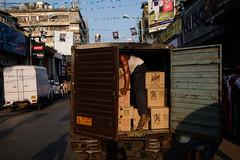 Kolkata, India (f.d. walker) Tags: asia india kolkata market man boxes truck surreal mystery streetphotography sunlight street shadow strange candidphotography candid colorphotography clothes city colors color contrast