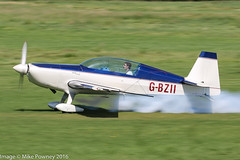G-BZII - 1999 build Extra EA.300L, rolling for departure on Runway 26L at Barton (egcc) Tags: 119 aerobatic barton cityairport ea300l egcb extra extra300l gbzii lightroom manchester