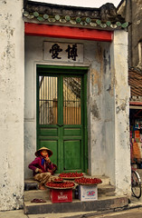 Buy a whistle? (juliajjphotography) Tags: hoian old sale street vietnam whistle woman travel journey mood life love happy trip world horizon people embrace dream moody ambient art artistic live smile traveler dreaming