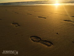 Footprints in time (J0nnyM) Tags: beach sunrise sun sand surf sunrays footprint prints nature coast ocean water morning shadows