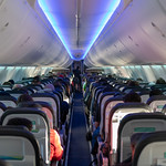 LOOKING DOWN THE 737 NEXT GEN CABIN FROM THE BACK thumbnail