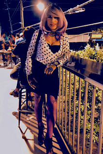 Cortney - The Purple look --  Lavender wig and purple nylons.... On the balcony at JR's in Dallas